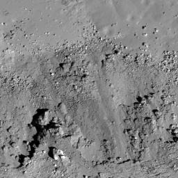 A subset of NAC Image M112162602L showing landslides (bottom) covering impact melt on the floor (top) of a fresh Copernican-age crater at the edge of Oceanus Procellarum and west of Balboa crater taken by NASA's Lunar Reconnaissance Orbiter.