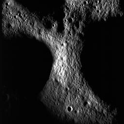 A junction between the rims of three craters on the floor of Peary crater near the lunar north pole is evident in this image taken by NASA's Lunar Reconnaissance Orbiter.