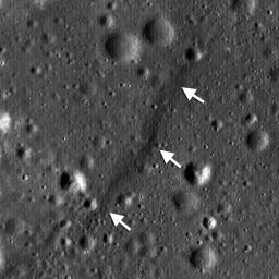 NASA's Lunar Reconnaissance Orbiter shows a lobate scarp in the mare basalts of Aitken crater on the lunar farside (arrows).