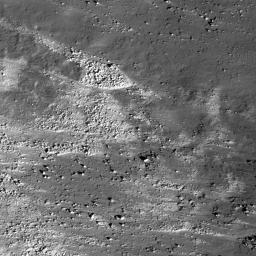 This image taken by NASA's Lunar Reconnaissance Orbiter shows the slopes of the Vallis Schröteri, 'Cobra Head' are boulder-rich and display albedo variations -- bright to dark.