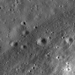 This image taken NASA's Lunar Reconnaissance Orbiter is a high-resolution view of part of the floor of Riccioli Crater. The view is centered on the boundary between a spur of the crater's central peak materials and volcanic lava flow deposits.