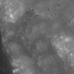This image taken NASA's Lunar Reconnaissance Orbiter shows the wall of crater Van de Graaff C, where brighter material is exposed by more active processes associated with steeper slopes, recent small craters, and even individual rolling boulders.