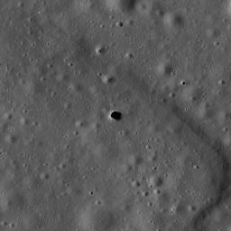The Marius Hills pit is a possible skylight in a lava tube in an ancient volcanic region of the Moon called the Marius Hills. This image was taken by NASA's Lunar Reconnaissance Orbiter.