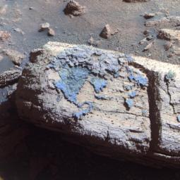 This false color image from the panoramic camera on NASA's Mars Exploration Rover Opportunity shows a rock called 'Chocolate Hills,' which the rover found and examined at the edge of a young crater called 'Concepci�n.'