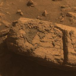 This image from the panoramic camera on NASA's Mars Exploration Rover Opportunity shows a rock called 'Chocolate Hills,' which the rover found and examined at the edge of a young crater called 'Concepci�n.'