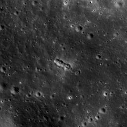 This image taken by NASA's Lunar Reconnaissance Orbiter shows a small secondary crater chain near the southwestern margin of Mare Orientale, within the Inner Rook Mountains. The ~125-meter-long chain lies within the Orientale multi-ring basin.