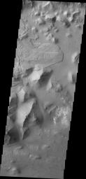 The landslide deposit in this image captured by NASA's 2001 Mars Odyssey spacecraft is located in Aurorae Chaos (distinctive area of broken terrain). Several regions of chaotic terrain are located on the eastern end of the Valles Marineris system.