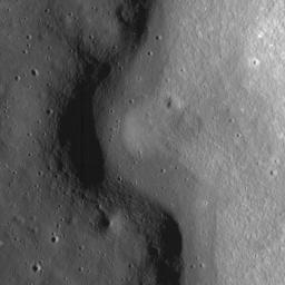 A sinuous rille created by a lava flow snakes around the base of a massif in the Prinz-Harbinger region on the Moon in this image taken by NASA's Lunar Reconnaissance Orbiter.