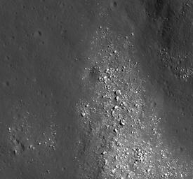 NASA's Lunar Reconnaissance Orbiter's view of boulders on an outlying rampart of the complex central peak of Tsiolkovskiy crater.