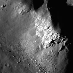NASA's Lunar Reconnaissance Orbiter captured this image close up view of Copernicus crater showing light-toned fractured bedrock exposed on the higher slopes on the central structural uplift.