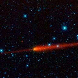 This image from NASA's Wide-field Infrared Survey Explorer features comet 65/P Gunn. Comets are balls of dust and ice left over from the formation of the solar system. The comet's tail is seen here in red trailing off to the right of the comet's nucleus.