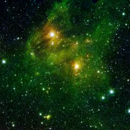 Two extremely bright stars illuminate a greenish mist in this image from the new 'GLIMPSE360' survey from NASA's Spitzer Space Telescope. The fog is comprised of hydrogen and carbon compounds called polycyclic aromatic hydrocarbons.