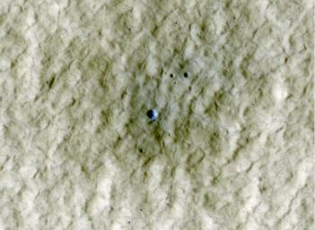 At the center of this view of an area of mid-latitude northern Mars, a fresh crater about 6 meters (20 feet) in diameter holds an exposure of bright material, blue in this false-color image observed by NASA's Mars Reconnaissance Orbiter.