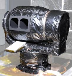 The Mars Climate Sounder instrument, shown here prior to its installation onto NASA's Mars Reconnaissance Orbiter for the mission's 2006 launch, will get a similar-looking sibling at Mars in 2016.