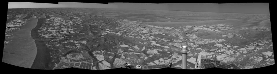 This panorama taken by NASA's Mars Exploration Rover Opportunity includes an outcrop informally called 'Cambridge Bay.' Opportunity examined this outcrop in August 2010.