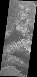 Parts of Meridiani Planum have a surface that appears to be composed of different layers of material. In this image taken by NASA's Mars Odyssey the contrast of bright and dark materials indicates the different layers.
