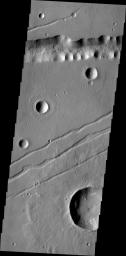 The channel-like features in this image captured by NASA's Mars Odyssey are fault bounded down-dropped blocks of material. These tectonic features are called Labaetis Fossae and are located on the eastern margin of the Tharsis Volcanic complex.