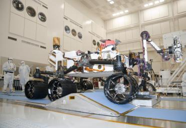 The suspension system on NASA Mars rover Curiosity easily accommodates rolling over a ramp in this Sept. 10, 2010, test drive inside the Spacecraft Assembly Facility at NASA's Jet Propulsion Laboratory, Pasadena, Calif.