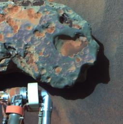 NASA's Mars Exploration Rover Opportunity found this image of a meteorite. The science team used two tools on Opportunity's arm, the microscopic imager and the alpha particle X-ray spectrometer, to inspect the rock's texture and composition.