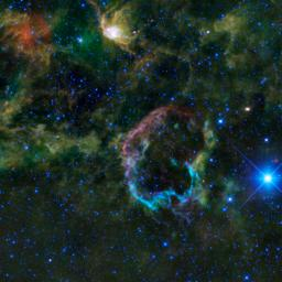 This oddly colorful nebula is the supernova remnant IC 443 as seen by NASA's Wide-field Infrared Survey Explorer; the Jellyfish nebula is particularly interesting because it provides a look into how stellar explosions interact with their environment.