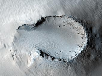 This image from NASA's Mars Reconnaissance Orbite is centered on a small cone on the side of one of Mars' giant shield volcanoes. The cone shows some layers of hard rock but most of it is made of relatively soft material.