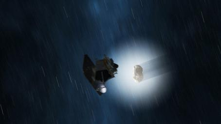 This artist's concept shows a view of NASA's EPOXI mission spacecraft during its Nov. 4, 2010 flyby of comet Hartley 2. The fluffy shell around the comet, called a coma, is made up of gas and dust that blew off the comet's core, or nucleus.