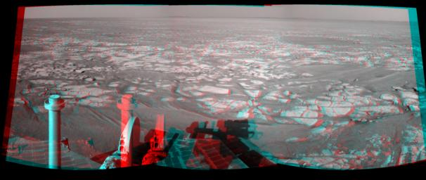 This mosaic of images from NASA's Mars Exploration Rover Opportunity shows surroundings of the rover's location following an 122.2-meter (401-foot) drive on Oct. 25, 2010. 3D glasses are necessary.