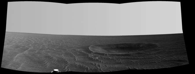 This mosaic is a view from NASA's Mars Exploration Rover Opportunity of 'Yankee Clipper' crater which carries the name of the command and service module of NASA's 1969 Apollo 12 mission to the moon.