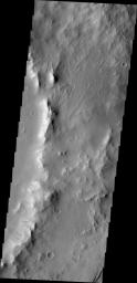 This image from NASA's Mars Odyssey shows dark slope streaks, a common feature on the rim of this unnamed crater within Tikhonravov Crater.