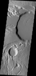 This image from NASA's Mars Odyssey shows part of the summit caldera of Ceraunius Tholus, one of the smaller volcanoes of the Tharsis region.