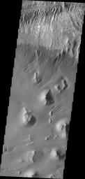 This image from NASA's Mars Odyssey of the floor of Ganges Chasma shows eroded fill material and extensive sand deposits.