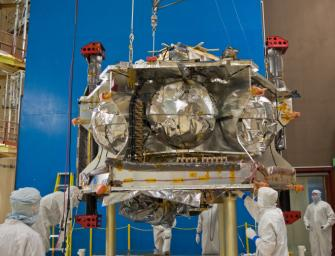 Technicians position NASA�s Juno spacecraft on a dolly prior to the start of a round of acoustical testing.