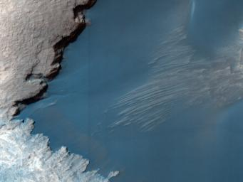 This image from NASA's Mars Reconnaissance Orbiter shows part of the floor of Rabe Crater, a large impact crater in the Southern highlands. Dark dunes cover part of crater's floor, and contrast with the surrounding bright-colored outcrops.