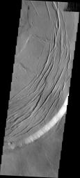 This image captured by NASA's Mars Odyssey shows one edge of the complex caldera at the summit of Olympus Mons.