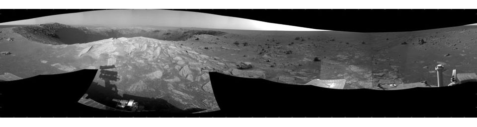 A football-field-size crater, informally named 'Santa Maria,' dominates the scene in this 360-degree view from NASA's Mars Exploration Rover Opportunity.