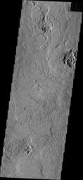 This image from NASA's Mars Odyssey shows a portion of Avernus Colles. The term 'colles' means small hills, and the surface here is being fractured into many small hills and mesas.
