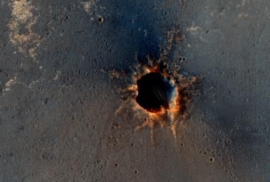 NASA's Mars Reconnaissance Orbiter acquired this color image on March 9, 2011, of 'Santa Maria' crater, showing NASA's Mars Exploration Rover Opportunity perched on the southeast rim. The rover is the bluish speck on the crater rim (arrow).