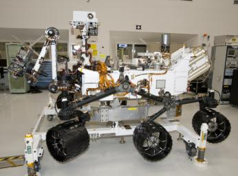 The rover for NASA's Mars Science Laboratory mission, named Curiosity, is about 3 meters (10 feet) long, not counting the additional length that the rover's arm can be extended forward. The front of the rover is on the left in this side view.
