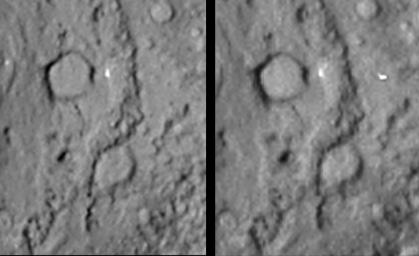 Reversed stereo image pair covering the region of NASA's Deep Impact site from the Stardust-NExT mission on comet Tempel 1. A large crater is seen at the top of the image.