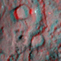 This anaglyph shows the region where NASA's Deep Impact mission sent a probe into the surface of comet Tempel 1 in 2005. 3D glasses are necessary to view this image.
