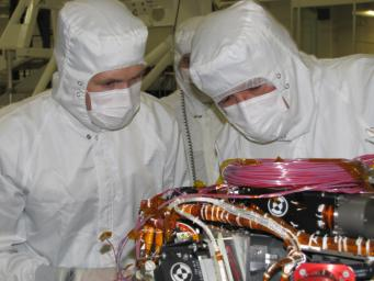 Grad student Nicholas Boyd (left) and Principal Investigator Ralf Gellert, both of the University of Guelph, Ontario, Canada, prepare for the installation of the Alpha Particle X-ray Spectrometer sensor head during testing at NASA's JPL.