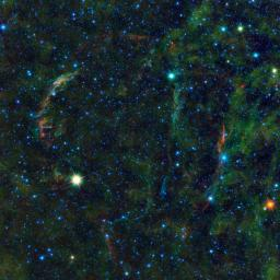 This large mosaic image from NASA's Wide-field Infrared Survey Explorer, features the wreckage of an exploded star, as well as other stars nearing the end of their lives.