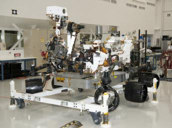 The rover for NASA's Mars Science Laboratory mission, named Curiosity, is seen here inside the Spacecraft Assembly Facility at NASA's Jet Propulsion Laboratory, Pasadena, Calif. Support equipment is holding the rover slightly off the floor.