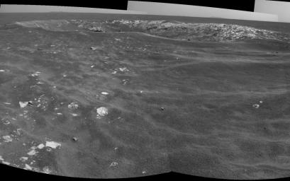 NASA's Mars Exploration Rover Opportunity recorded this view of a crater informally named 'Freedom 7' shortly before the 50th anniversary of the first American in space: astronaut Alan Shepard's flight in the Freedom 7 spacecraft.
