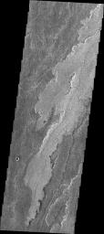 The volcanic flows in Daedalia Planum originated from Arsia Mons. This image from NASA's Mars Odyssey shows a tiny portion of Daedalia Planum.