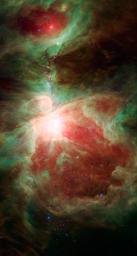 This image from NASA's Spitzer Space Telescope shows what lies near the sword of the constellation Orion -- an active stellar nursery containing thousands of young stars and developing protostars. Many will turn out like our sun.