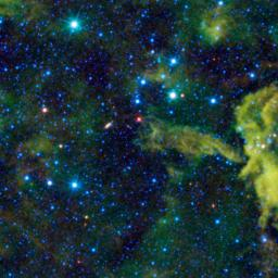 This stellar object is called Spitzer 073425.3-465409, as seen by NASA's Wide-field Infrared Survey Explorer; the cloud CG4 might be imagined as a cosmic alligator eating its way across the sky.
