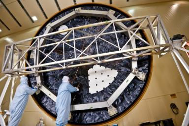 Technicians at Lockheed Martin Space Systems, Denver, prepare the heat shield for NASA's Mars Science Laboratory. With a diameter of 4.5 meters (nearly 15 feet), this heat shield is the largest ever built for a planetary mission.