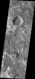 It is sometimes difficult to figure out the history of the surface of Mars as seen in visible wavelength images. This image from NASA's 2001 Mars Odyssey is located on the northern margin of Hellas Basin and hints at a layered surface.