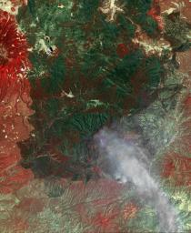 NASA's Terra spacecraft acquired this image of the Wallow fire in Arizona on June 21, 2011; vegetation appears in red, bare ground in shades of tan, burned areas in black and very-dark red; and smoke from the active fire front appears gray.